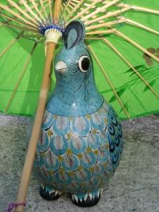 Bird Under Parasol